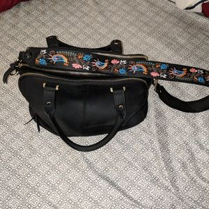 Black bag with embroidered strap